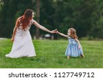 laughing woman in light dress... | Shutterstock . vector #1127749712