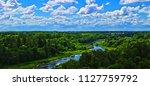 small dark blue river in... | Shutterstock . vector #1127759792