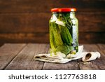 Canned Cucumbers In A Jar On A...
