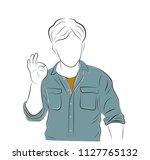 man gesturing ok sign on light...   Shutterstock .eps vector #1127765132