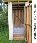 dry wooden outdoor toilet near... | Shutterstock . vector #1127768108