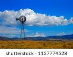 windmill on hillside in...   Shutterstock . vector #1127774528