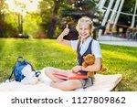 schoolgirl student happy... | Shutterstock . vector #1127809862