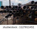 oil drill pipe. rusty drill... | Shutterstock . vector #1127811452