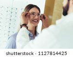 ophthalmologist doing a visual...   Shutterstock . vector #1127814425
