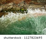 aerial top view of sea waves... | Shutterstock . vector #1127823695