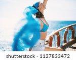attractive brunette enjoying... | Shutterstock . vector #1127833472