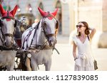 tourist woman enjoying a stroll ...   Shutterstock . vector #1127839085