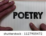 Small photo of Writing note showing Poetry. Business photo showcasing Literary work Expression of feelings ideas with rhythm Poems writing Notebook register line drawing office routine hand fingers busy work.