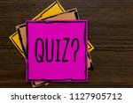 writing note showing quiz... | Shutterstock . vector #1127905712