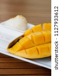 sliced mango with sticky rice  | Shutterstock . vector #1127933612