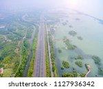 aerial view of the highway in... | Shutterstock . vector #1127936342