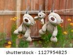 three teddy bear family hanging ... | Shutterstock . vector #1127954825