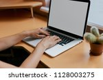 woman typing on her white... | Shutterstock . vector #1128003275