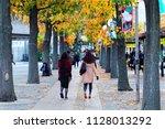 fall scenery of a city sidewalk ... | Shutterstock . vector #1128013292