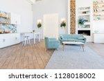 fashionable spacious apartment... | Shutterstock . vector #1128018002