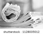 newspapers. folded and rolled... | Shutterstock . vector #1128035012