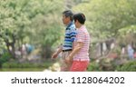 old couple talking together at... | Shutterstock . vector #1128064202