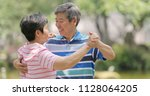 senior old couple dancing at...   Shutterstock . vector #1128064205