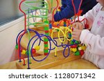 children playing with colorful... | Shutterstock . vector #1128071342