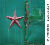 gate with a soviet red star... | Shutterstock . vector #1128081695