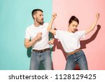 a couple of young funny and... | Shutterstock . vector #1128129425