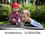 two children camping and having ... | Shutterstock . vector #112814206