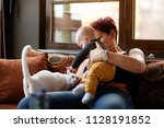 little boy with his mom playing ... | Shutterstock . vector #1128191852