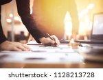 business team working planning... | Shutterstock . vector #1128213728