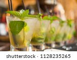 mojito cocktails in a row on... | Shutterstock . vector #1128235265