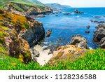 spring time landscape along... | Shutterstock . vector #1128236588