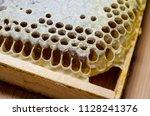 frame honeycomb full of honey   Shutterstock . vector #1128241376
