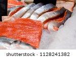 raw salmon fish for sale.   Shutterstock . vector #1128241382