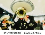 Small photo of Mexican musician with his trumpet and guitars