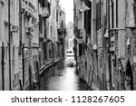 beautiful street of venice.... | Shutterstock . vector #1128267605