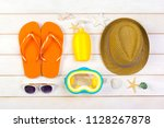 beachwear and accessories on a... | Shutterstock . vector #1128267878