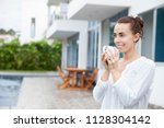 young woman holding a hot drink ... | Shutterstock . vector #1128304142