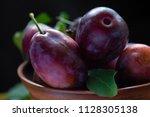 ripe big rural juicy plum close ... | Shutterstock . vector #1128305138