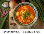 massaman gai  chicken massaman... | Shutterstock . vector #1128305708