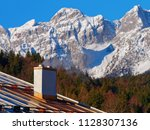 chimney closeup of home in a...   Shutterstock . vector #1128307136
