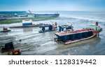 ship breaking yards ... | Shutterstock . vector #1128319442