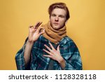 young sick guy wrapped in plaid ... | Shutterstock . vector #1128328118