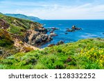 hiking along pacific coast... | Shutterstock . vector #1128332252
