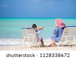 two happy people having fun on... | Shutterstock . vector #1128338672