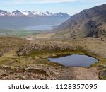 beautiful nordic landscape with ... | Shutterstock . vector #1128357095