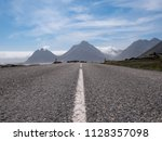 highway road to the mountains ... | Shutterstock . vector #1128357098