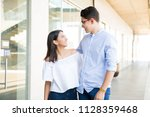 smiling male and female... | Shutterstock . vector #1128359468