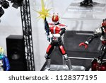 Small photo of KUALA LUMPUR, MALAYSIA -APRIL 7, 2018: Selected focused on fictional character action figure from Japanese popular series KAMEN RIDER. Various custom of Kamen Rider depending on its series and era.