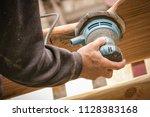 random orbit disc sander held... | Shutterstock . vector #1128383168