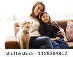 young mom  daughter and dog... | Shutterstock . vector #1128384812